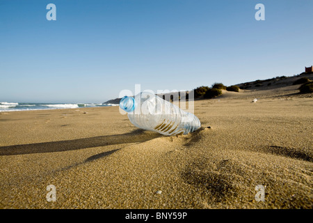 Plastic water bottle abandoned on beach, Souss-Massa National Park, Morocco - Stock Photo