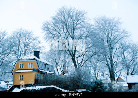 House in winter landscape - Stock Photo