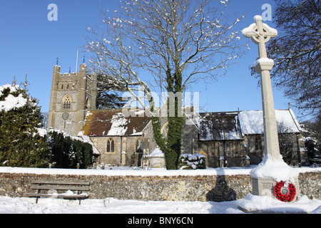 Saint Mary's Church and War Memorial, Hambleden village in the snow, Chiltern Hills, Buckinghamshire, England, UK - Stock Photo