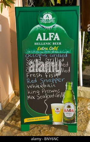 Signs outside taverna in Sidari on the Greek island of Corfu Greece GR - Stock Photo