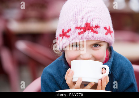 Young girl drinking hot chocolate - Stock Photo
