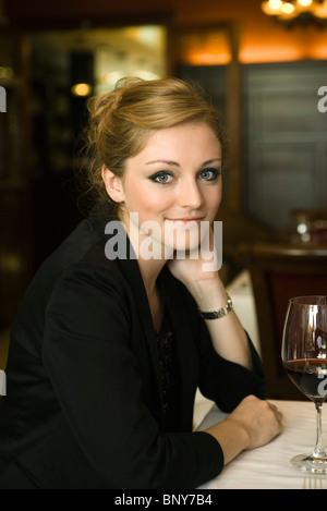 Woman in restaurant, portrait - Stock Photo