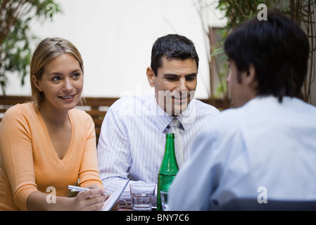 Business associates having casual meeting at cafe - Stock Photo