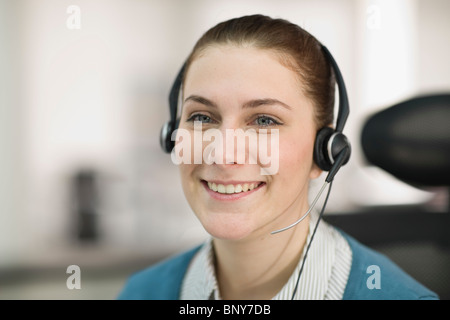 Portrait of a young receptionist - Stock Photo