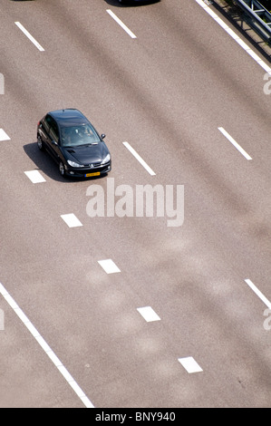 Aerial view of a car on the A10 motorway in the Amsterdam Zuid area of the Dutch capital - Stock Photo