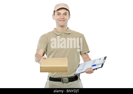 A delivery man bringing a package and holding out a clipboard - Stock Photo
