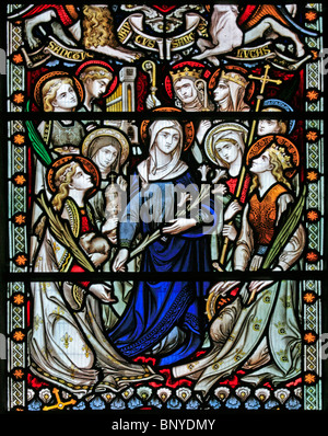 A stained glass window depicting the Virgin Mary surrounded by female saints, All Saints Church, Ladbroke, Warwickshire - Stock Photo