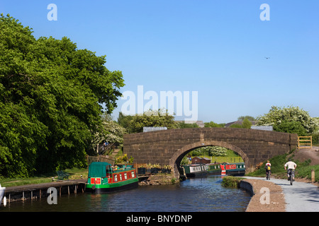 Narrow boats on the Leeds Liverpool Canal at Adlington in Lancashire - Stock Photo