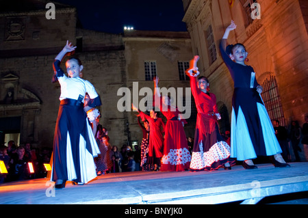 Arles, France, Feria 'Bullfighting Festival' Andalusian Women Performing on Stage Flamenco Dance in Costume - Stock Photo