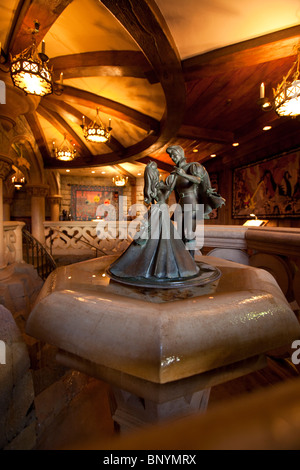 Statue of Cinderella dancing with her prince charming, in one of the rooms of her castle at Euro Disney, Disneyland, - Stock Photo