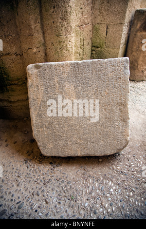Ancient writing on stone block, Archaeological museum, Rhodes, Greece - Stock Photo