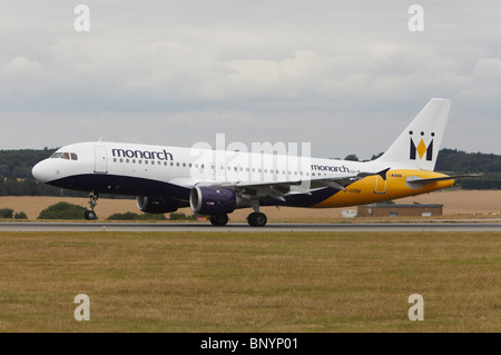 Monarch Airlines Airbus A320-212 landing at Luton Airport, Bedfordshire, England, United Kingdom - Stock Photo