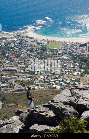 Man abseiling from Table Mountain, Cape Town, South Africa. - Stock Photo