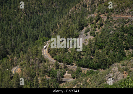 Sedona, Arizona - Oak Creek Vista on Highway 89A from Flagstaff to Sedona. Hairpin bends with RV motorhome and SUVs. - Stock Photo