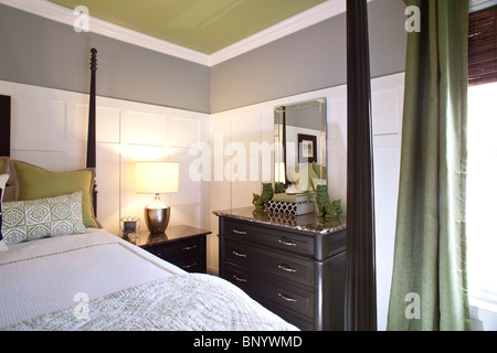 Detail of a contemporary bedroom with double four poster bed in American home - Stock Photo