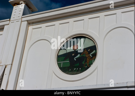 Stained glass style windows on the arcade on Brighton's East )Palace) Pier - Stock Photo