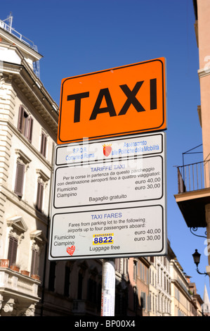 italy, rome, taxi stand sign with fares to the airports - Stock Photo
