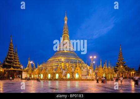 view of Shwedagon Pagoda at dusk, Yangon, Myanmar - Stock Photo