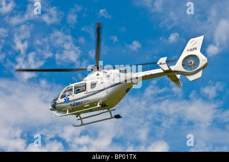 Eurocopter EC135 air ambulance taking off - Indre-et-Loire, France. - Stock Photo