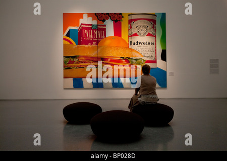 A visitor looks at a pop artwork named Still Life No. 33 by American artist Tom Wesselmann displayed at the Fine - Stock Photo