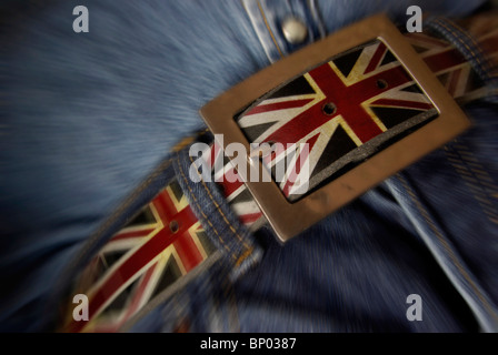 Tighten your belt, Tightening your belt concept featuring the UK flag. (cutting costs,Budget cuts) - Stock Photo
