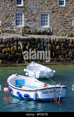 boats in the harbour at mousehole in cornwall, uk - Stock Photo