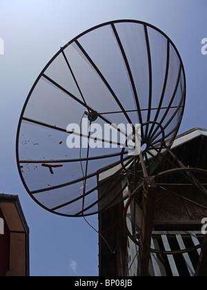 Huge satellite dish mounted near private house in Luang Prabang, Northern Laos - Stock Photo