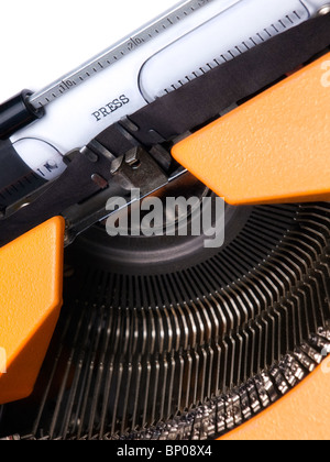 Closeup view of the typewriter and word PRESS typed on the paper. - Stock Photo