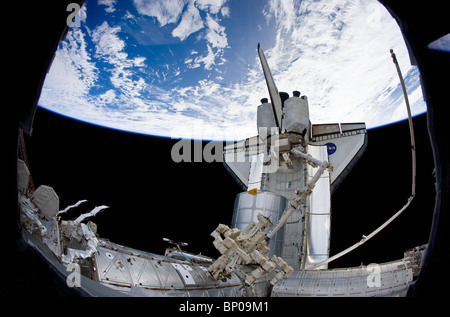 Space Shuttle Discovery docked at the International Space Station.  Image courtesy of NASA. - Stock Photo