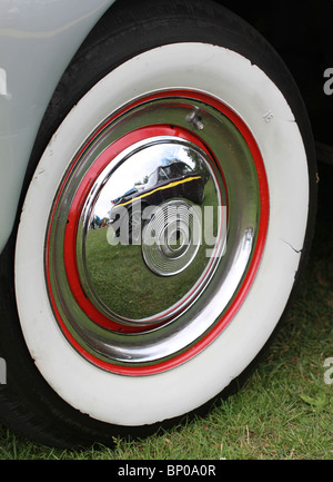 hillman imp reflected in wheel trim of humber super snipe mark 3 at a classic