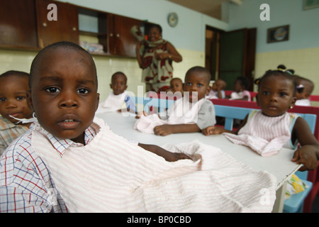 Togo, Lomé, Nursery & Kindergarten run by catholic nuns Meal time - Stock Photo
