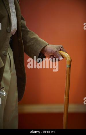 Elderly man's hand on walking stick - Stock Photo