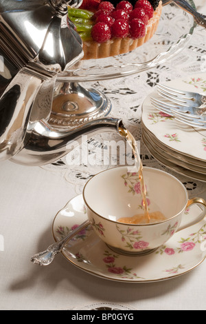 Silver Service, Pouring Tea with Dessert - Stock Photo