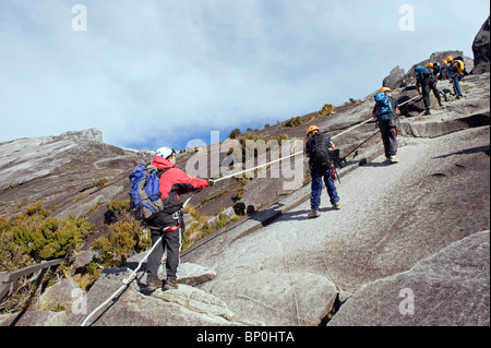 South East Asia, Malaysia, Borneo, Sabah, Kinabalu National Park, Malaysias highest mountain (4095m), hikers - Stock Photo