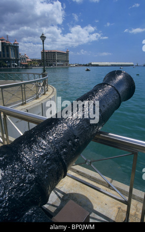 Old canon displayed on Caudon waterfront, Port Louis harbor. Mauritius Island. Indian Ocean - Stock Photo