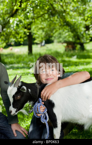 Boy with goat - Stock Photo