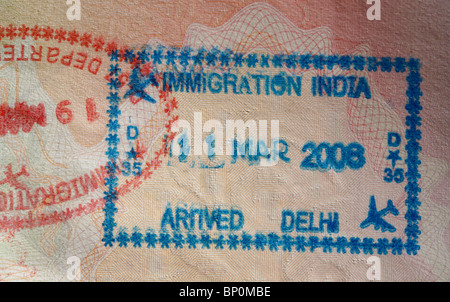 Indian immigration stamps in a UK passport. - Stock Photo