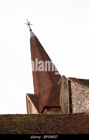 tiled spire on an english village church - Stock Photo