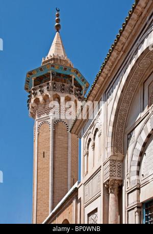 Octagonal-shaped minaret at the 1655 Hammouda Pasha Mosque (Hamouda Pacha al Mouradi) in the Tunis Medina - Stock Photo