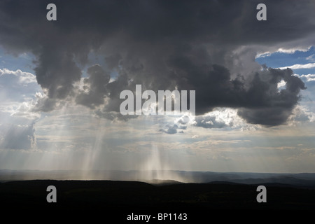 aerial view above rain showers pouring from cumulonimbus clouds outside Atlanta Georgia - Stock Photo
