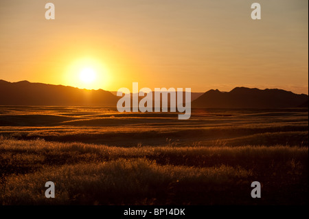 Sunset at Sesriem in Naukluft Park Central Namib desert Namibia - Stock Photo
