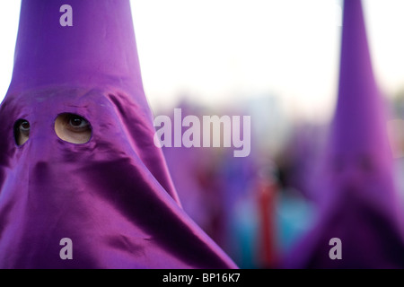 Believers in a procession on Good Friday, Seville, Spain - Stock Photo