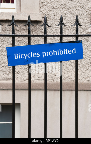 Sign on an iron fence 'Bicycles Prohibited' - Stock Photo
