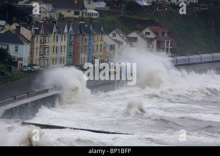 Huge waves crash over the sea wall and railway line at Dawlish in Devon. Picture by James Boardman - Stock Photo