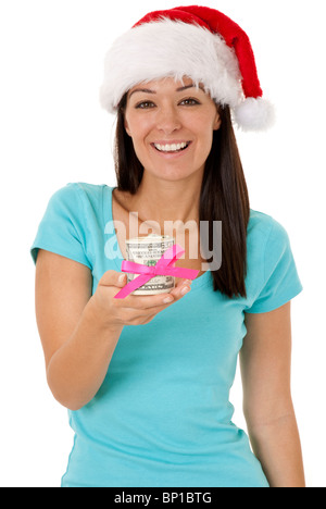 a young lady looking festive holding 50 dollar bills wrapped in a bow - Stock Photo