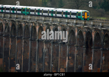 A train traveling towards London crosses over the Ouse Valley Viaduct. Picture James Boardman. - Stock Photo