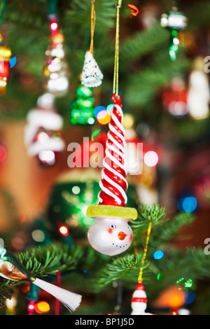 Oregon, United States Of America; Ornaments Hanging From A Christmas Tree - Stock Photo