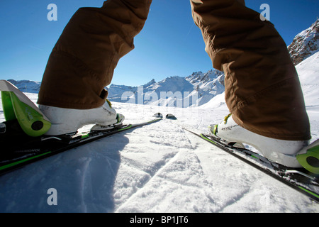 France, Alps, Savoie, Courchevel 1850, female skier - Stock Photo