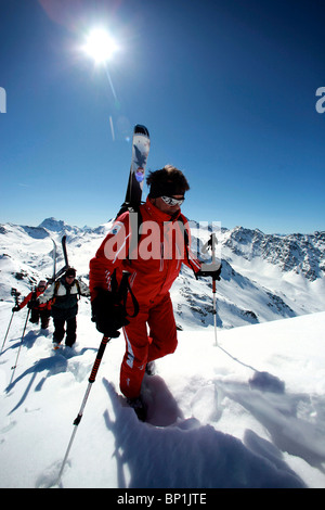 France, Alps, Savoie, Méribel-Mottaret, off piste skiers walking - Stock Photo