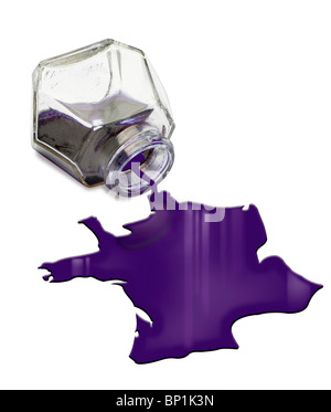 Map of France dropping from ink bottle - Stock Photo